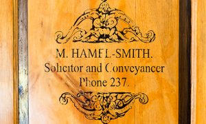 replica of the original letterhead of the founder of the company, 'Mikey' Hamel-Smith, as seen on the door to Mikey's Corner (a reproduction of his office at the Firm which houses his original desk).